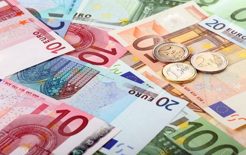 11173691-Different-euro-banknotes-and-coins-Stock-